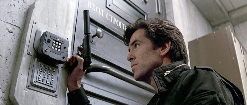 Bond with the pistol fitted with a suppressor in the film's opening.