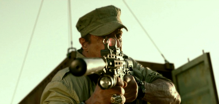 In a bit of a switch-up, Ross uses an Noveske/Colt Hybrid carbine with a suppressor in the film's opening sequence.