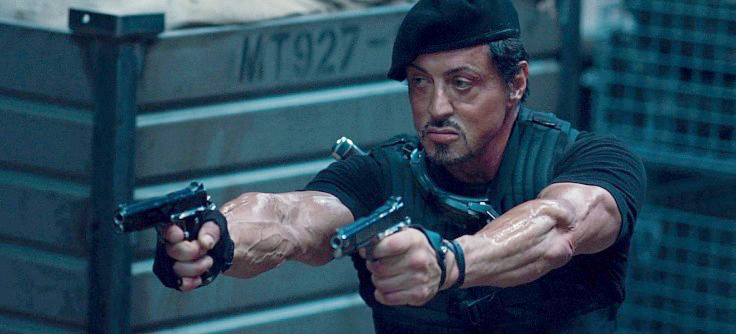 Stallone as Barney Ross with his customized twin Kimber Gold Combat II 1911 pistols.