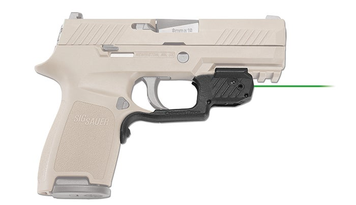 The new LG-420G green laser sight from Crimson Trace mounts to the forward rail segment, but feature a custom-shaped trigger guard form that positions an instinctive-activation button on the forward g