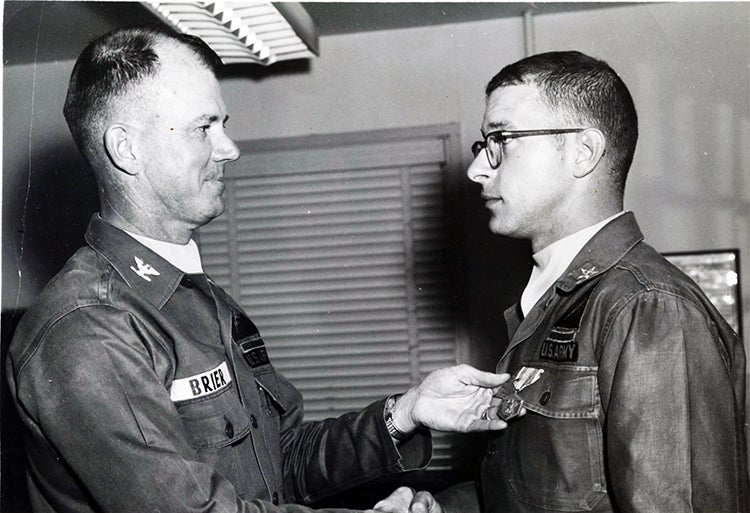 Receiving the Army Commendation Medal while stationed at Fort Hood, Texas. From there, he went to Fort Lewis, Washington, and then on to his all-expenses paid tour of SE Asia.