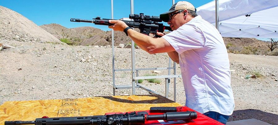 The author testing out the new MSR 15 Competition at the range.
