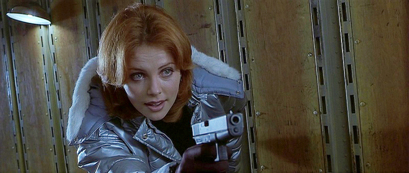 Playing a bad guy, Theron uses a Glock 22 in .40 S&W in *Reindeer Games*.