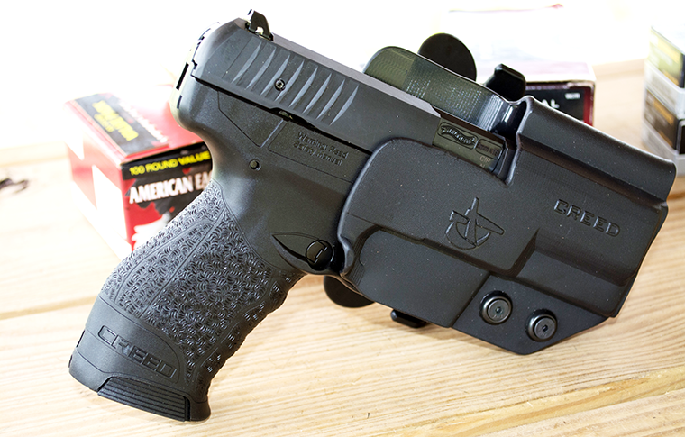 The author tested the Creed with this Comp-Tac International holster. I used the belt loop mount, which was rock solid, but the International also comes with paddle and offset belt mounts. The offset