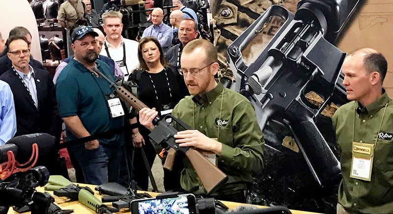 Ryan Repp of Brownells holding the new BRN-10A, a copy of Eugene Stoners' original AR-10 rifle, while announcing the company's first firearms line, Retro Rifles.