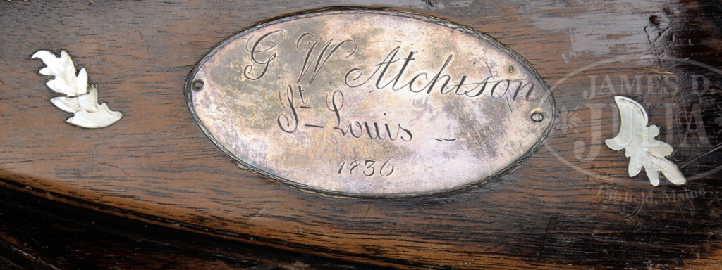 The right side of the stock with an engraved plaque.