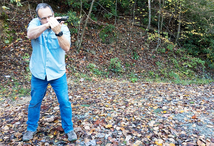 The aggressive cant angle of the handgun allows you to hold it close without an uncomfortable wrist bend and puts the sights in front of the left eye if you're shooting right-handed.