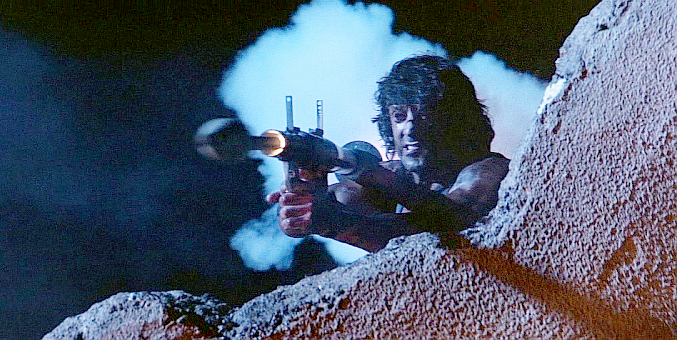Rambo fires an RPG-7 during the first escape from the Soviet fort.