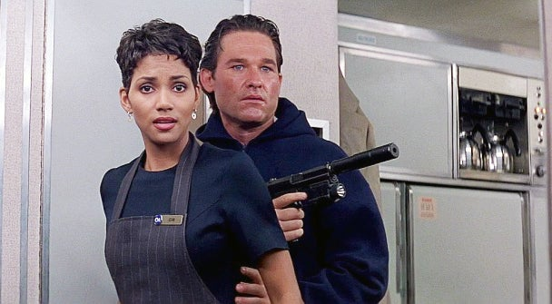 Grant with his Mk23 and a young Halle Berry in one of her earliest film roles.