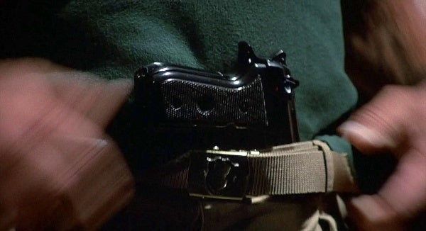 Matrix puts a Beretta 92FS in his belt, but never gets to use it.