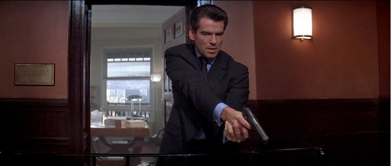 Bond uses an M1911A for the first time in the Brosnan era.