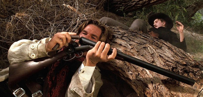 Wyatt performing a tactical reload from cover with his 10-gauge. Notice the third trigger—this was used to open the shotgun's action.