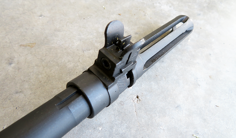 The M1A is equipped with a slotted flash hider similar to what original M14 muzzle devices.