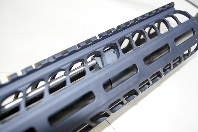 The M-Lok system has attachment cutouts on all sides except the top.