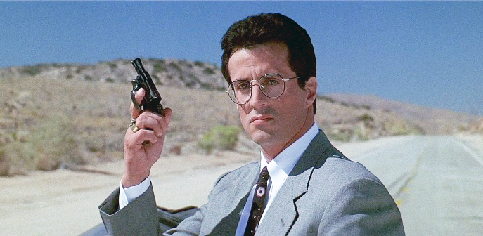Stallone as Ray Tango with his Smith & Wesson Model 36 revolver in .38 Special.