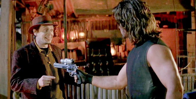 Snake aims one of his S&W Model 629 PC revolvers.