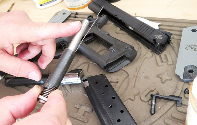 With 1911s like the TRP and TAC series pistols, lightly coat the outside of full length recoil rod with oil.