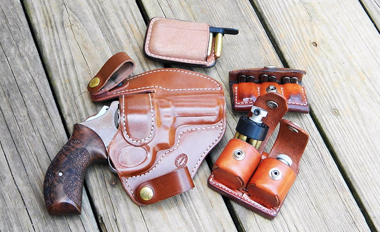 Ammunition carrying options for revolvers: Clockwise- speed strips, 3x2 pouch, speedloader.