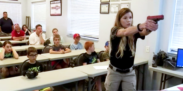 First, the kids get classroom instruction where they learn gun safety and how the handgun they'll be using operates.