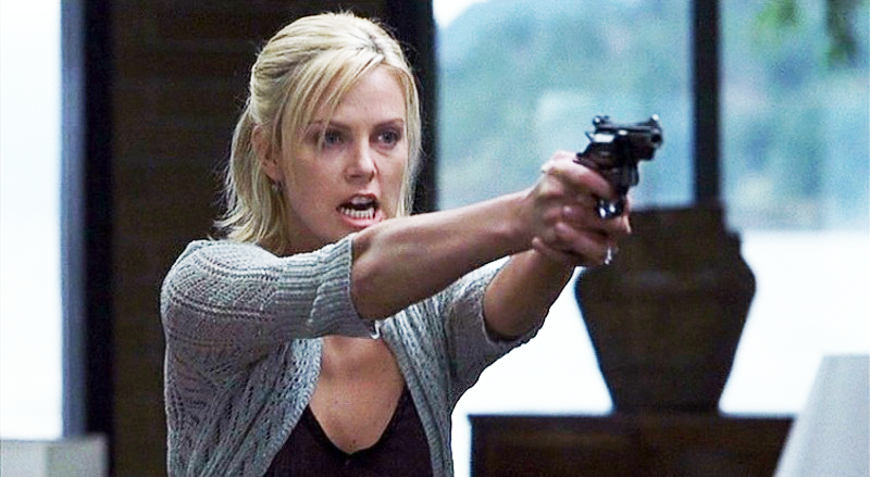 Theron aiming an S&W Model 19 at Kevin Bacon's character.