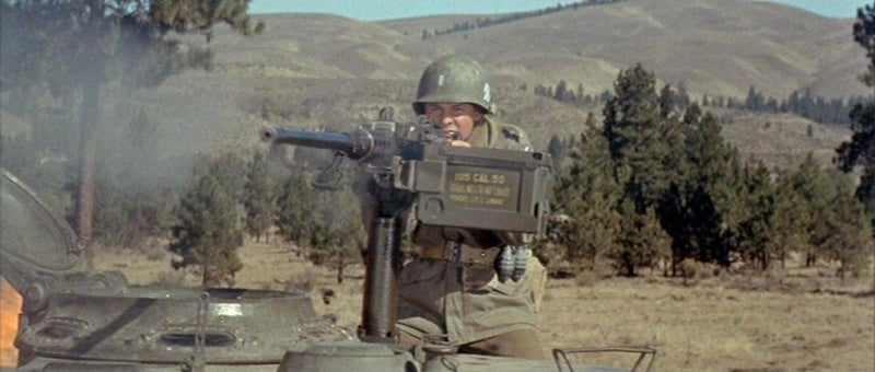 Audie Murphy fires a Browning M2HB in *To Hell And Back* (1955).