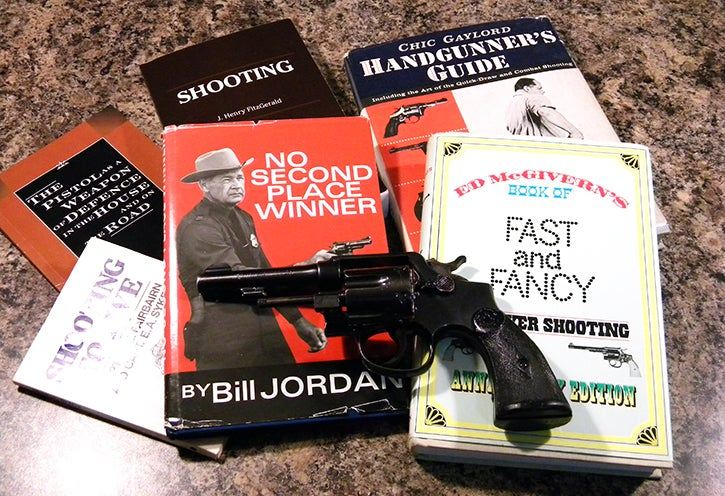A Smith & Wesson Model 67 along with the basic required literature to understand the lure and lore of the wheelgun.