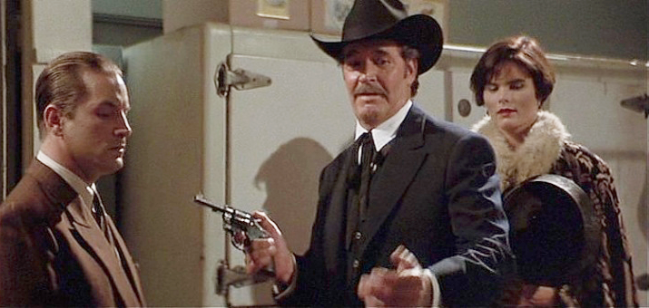 Earp holds a Colt Official Police revolver.