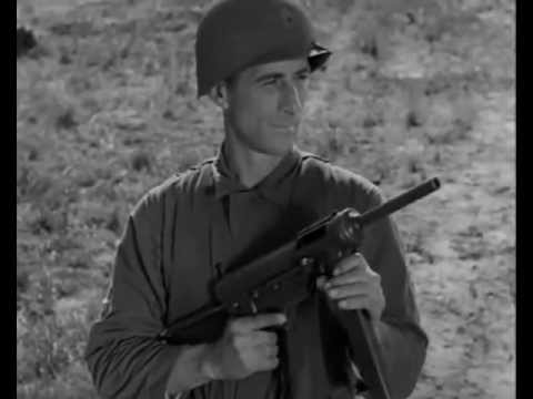 A WWII era soldier with an M3 submachine gun, better known as the Grease Gun, which was widely issued from the 1940s through the 1970s.