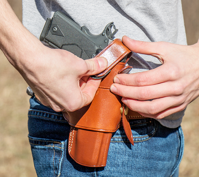 If your holster has a retention strap, activate it after you let go of your handgun. In some cases, this is best done with help from the support hand. Some shooters make the mistake of using their sup
