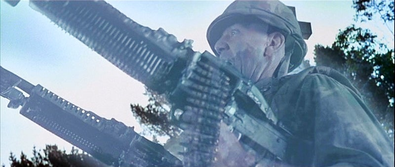 Ermey as a spectre wielding two M60 machine guns.