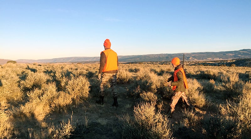 Even with a lightweight gun, you need to take regular breaks when hiking the high country looking for elk.
