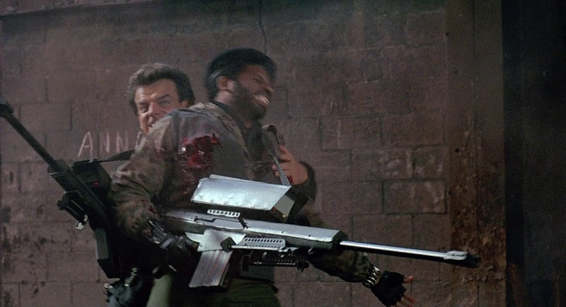 RoboCop shoots Joe while he holds one of the Cannons.