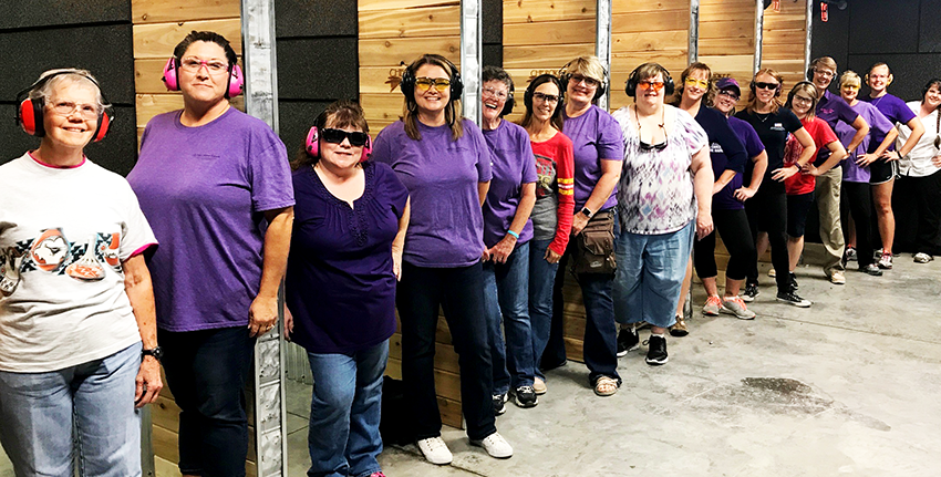 This group belongs to a chapter of The Well Armed Woman, which get together monthly for meetings and firearm training.
