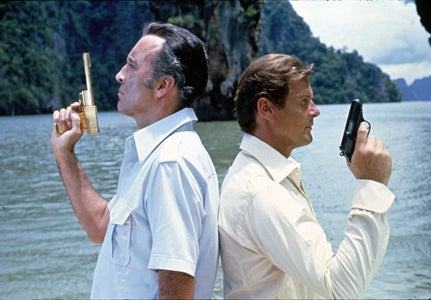Bond and Scaramanga begin their duel, each with their signature pistols.