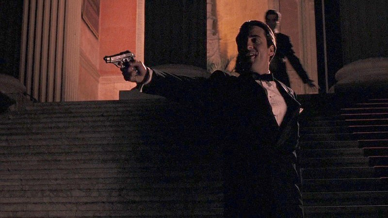 Vincent fires his Beretta Model 70 on the opera house steps.