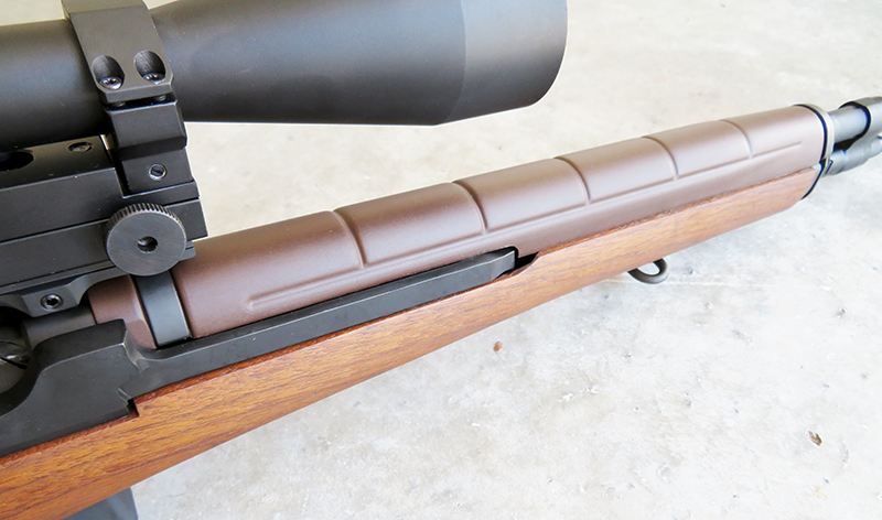 The handguard of the M1A is fiberglass, while the stock is wood.