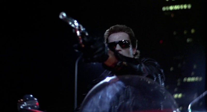 The T-800 aims his S&W Model 15.