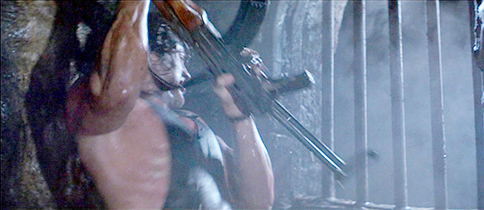 Rambo uses Mousa's AKMS with a wire stock to help break through a grate in the sewer to escape the Soviet fort.