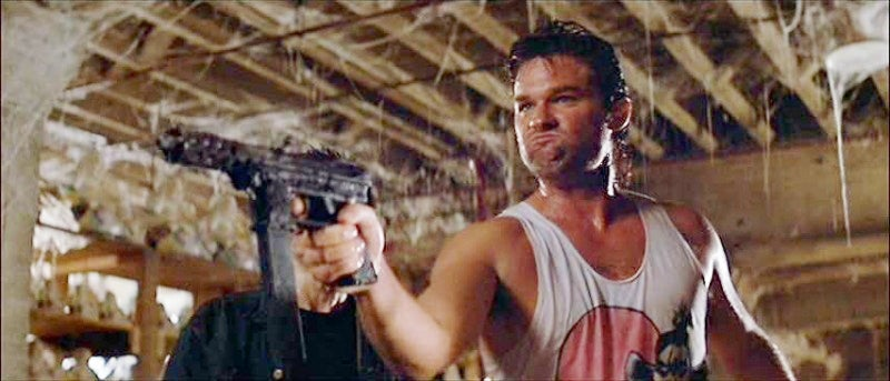 Russell with his TEC-9 in *Big Trouble in Little China*.