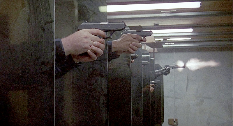 It appears all the cops in the Detroit Police Force carry the same HK P9 as Lewis. Forever the odd-one-out, RoboCop can be seen firing his Auto 9 at the far end of the range. Its report eventually sil