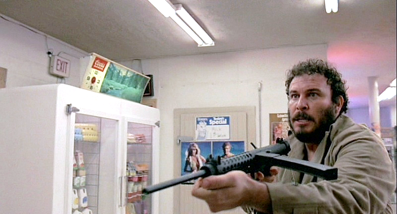 The convenience store robber with a Sterling Mk 6, a semi-auto carbine version of the Sterling SMG.