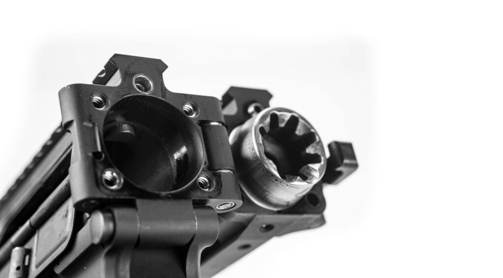 The tapered barrel extension and tapered receiver seat, visible here, fit into each other for a solid lockup when the rifle is deployed.
