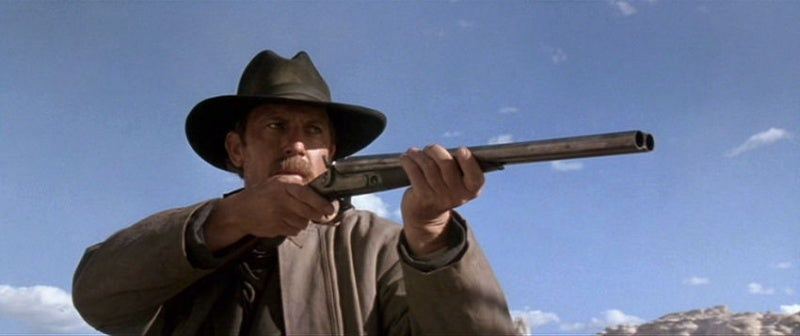 Wyatt with the shotgun during the canyon shootout.