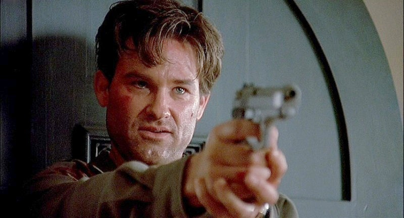 Russell as Michael Carr with a Beretta 92FS Inox.