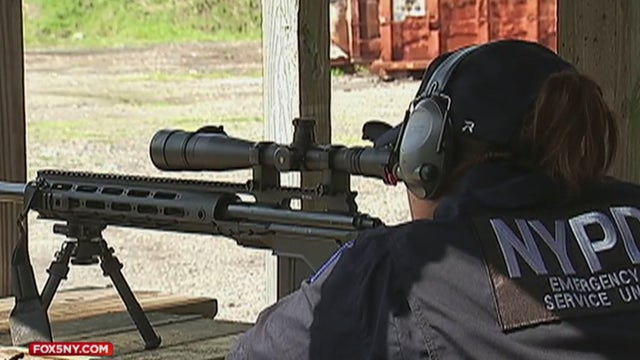 Det. Tina Guerrero at the range with her M24 sniper rifle.