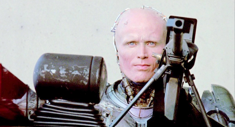 RoboCop gives a smirk after wasting the ED-209 robot with one shot from the Cobra Assault Cannon.