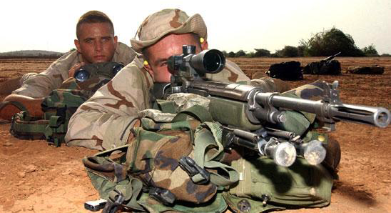 Here a spotter and shooter team use an M25 the modern equivalent to the M21. Note the lightweight Harris bipod attached to the rifle.