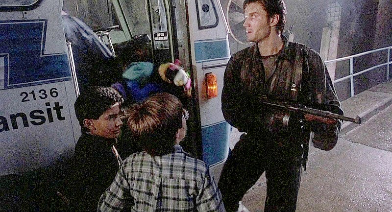 Here we see Castle with the Tommy Gun helping the kids escape, but he never fires it.