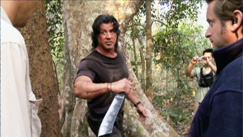 A behind-the-scenes shot of Stallone with the Rambo IV knife.