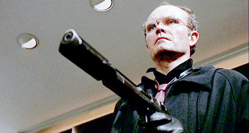 Clarence Boddicker with his suppressed Desert Eagle Mark I.